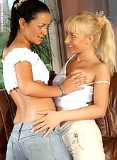 Tempting lesbians dildo on couch