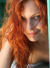 Slender redhead girl flaunting her naked body