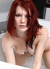 Sexy Lynette is taking a foamy bath and exposing her stunning curves