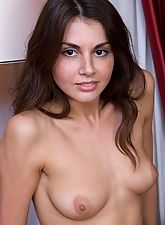 nubile sex, Curly small tits brunette posing naked on the couch